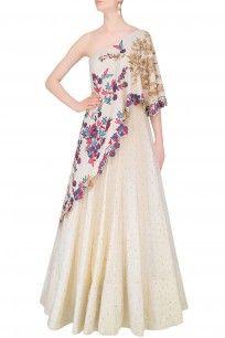 Vanilla Color One Shoulder Gown With Embroidered Aymmetric Cape #lehenga #off-white #weddingseason #celebration #ethnic #traditional #MonikaNidhii #perniaspopupshop #shopnow #happyshopping