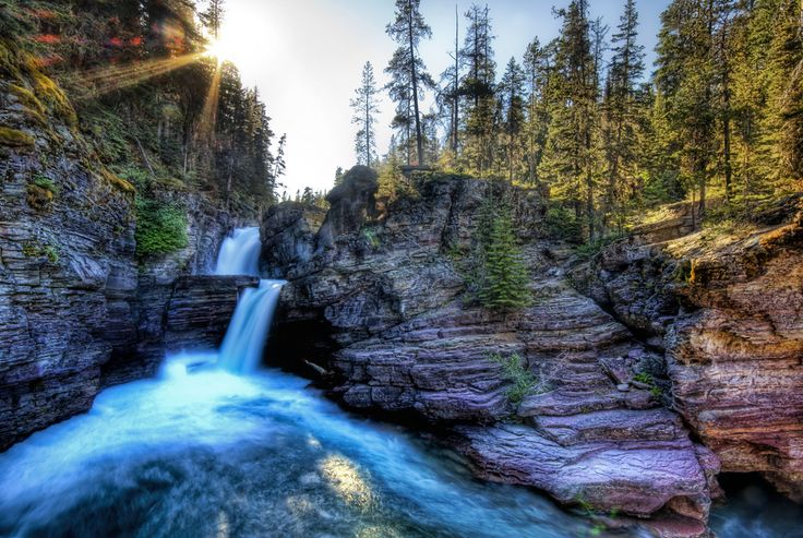 This place is deep inside Glacier National Park. The only bad thing about photography is I can't show how deafening the sound of the waterfall inside the canyons was! It ricocheted around the rocky walls and seemed to be perfectly acoustic echo chamber. I didn't get in, but the water seemed super-cold.  - Glacier National Park, Montana  - Photo from #treyratcliff Trey Ratcliff at http://www.StuckInCustoms.com
