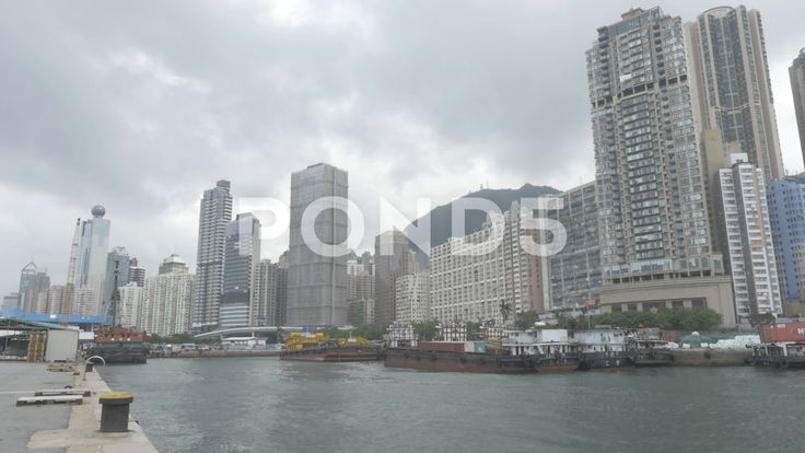 Hong Kong Skyline From Pier Dock Yard Sea - Stock Footage | by RyanJonesFilms