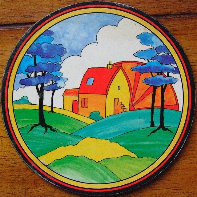 I absolutely adore this Clarice Cliff plate. Love the bright colors, love the house, love the landscape. Could be my inspiration piece.