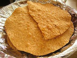 Papadam, (Hindi: पापड़म) (also known as Papad in Northern India or Appadam in Telugu and Pappadum in rest south India; spellings vary) is a thin, crisp disc-shaped Indian food typically based on a seasoned dough made from black gram (urad flour), fried or cooked with dry heat. Flours made from other sources such as lentils, chickpeas, rice, or potato, can be used.