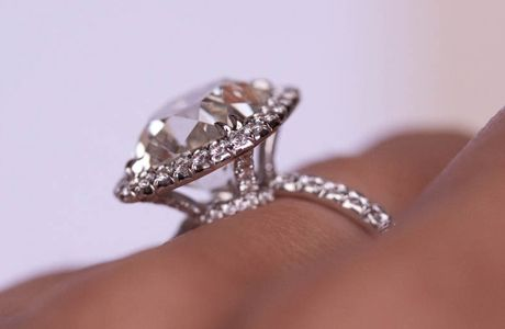 Antique style Cushion cut diamond halo ring