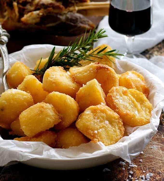 Truly Crunchy Roast Potatoes Par Boil Rough Up The Surface Dust With Semolina Then Bake In A Ve Recipetin Eats Nigella Lawson Recipes Crispy Roast Potatoes
