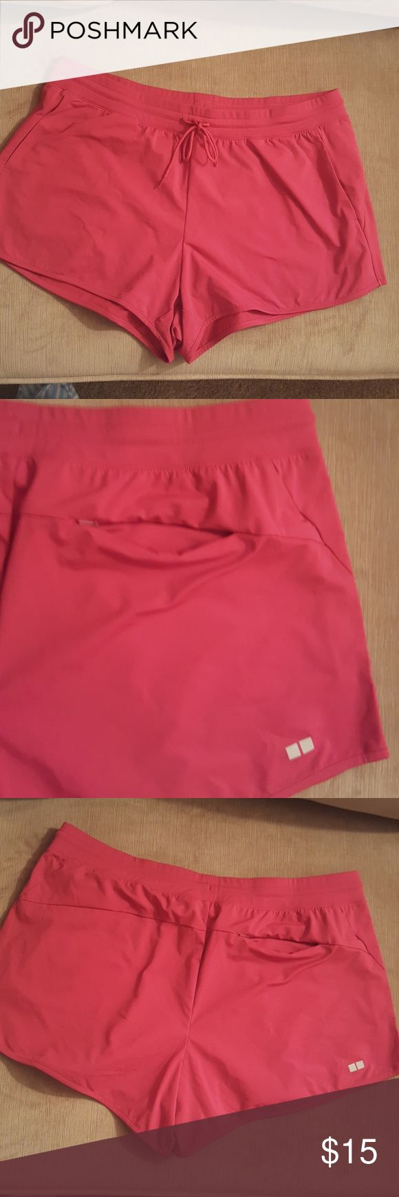 Workout women dry-ex ultra stretch shorts sz XL NWT. Never been worn. Red burgundy color shorts. 100% polyester. Sz XL. Perfect fit.  Super comfy. With adjustable string. With 1 back zip pockets and 2 front pockets. Uniqlo Shorts