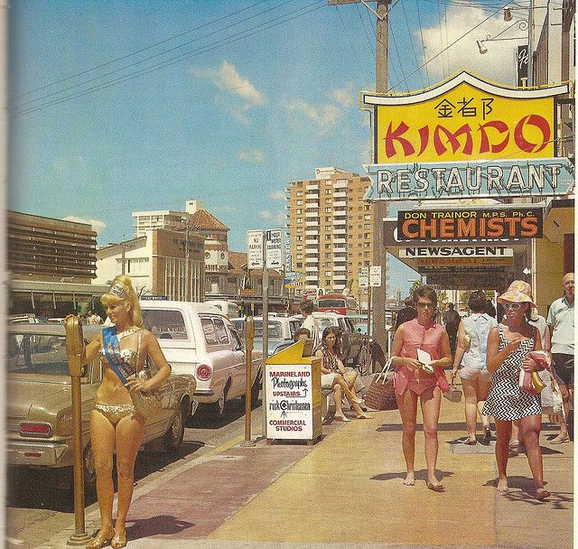 Surfer's Paradise, Queensland, c. late 1960s. Note the meter maid putting coins in the parking meters :)