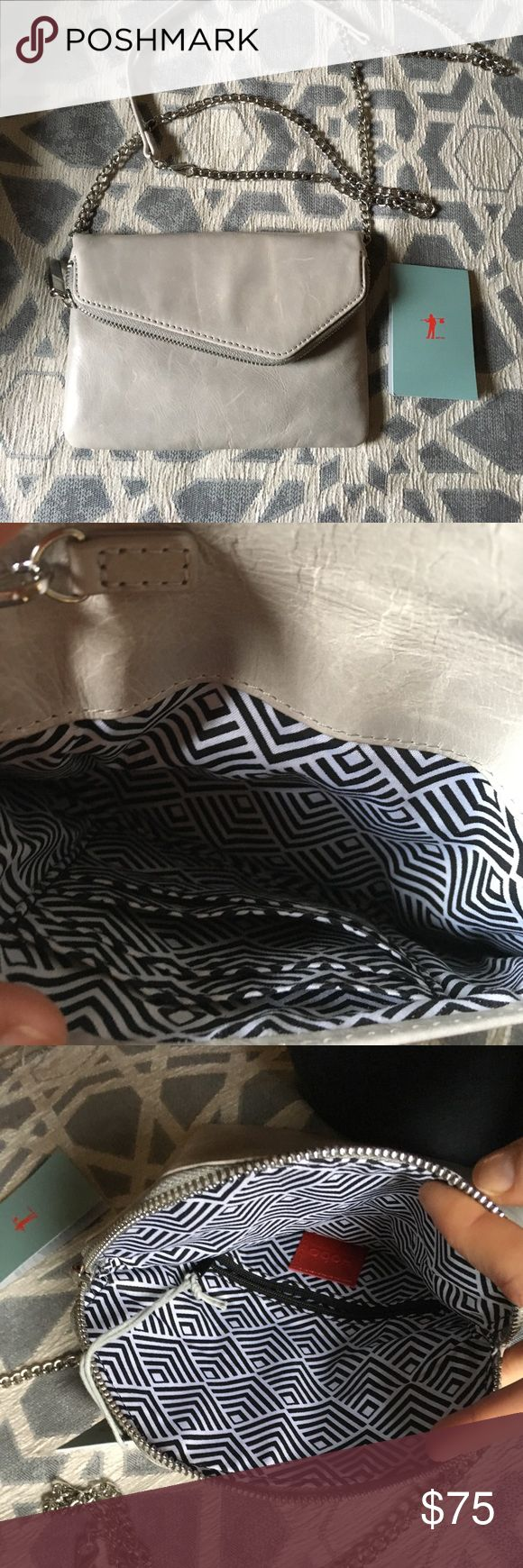HOBO Grey and Silver Clutch Cross-body Bag NWT New with tags, Hobo International grey leather cross body clutch bag. Detachable and adjustable straps. HOBO Bags