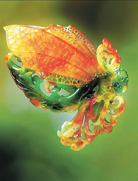"""One of Wang Junyi's highly praised works is this butterfly shaped from a piece of jadeite that gradually """"changes"""" colors."""