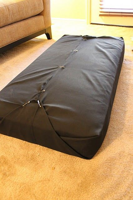 Upholster a twin mattress to use as a cushion by wrapping it in fabric like  a present and then pinning. Use with pallet couch. (going to wrap an old  baby ...