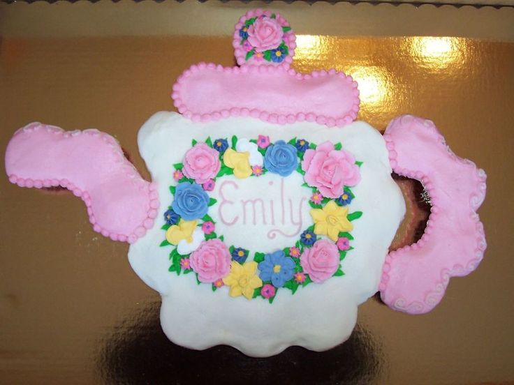 Teapot Cupcake Cake Strawberry and Vanilla cupcakes with vanilla and strawberry buttercream icing. Made for a little girl's tea party...