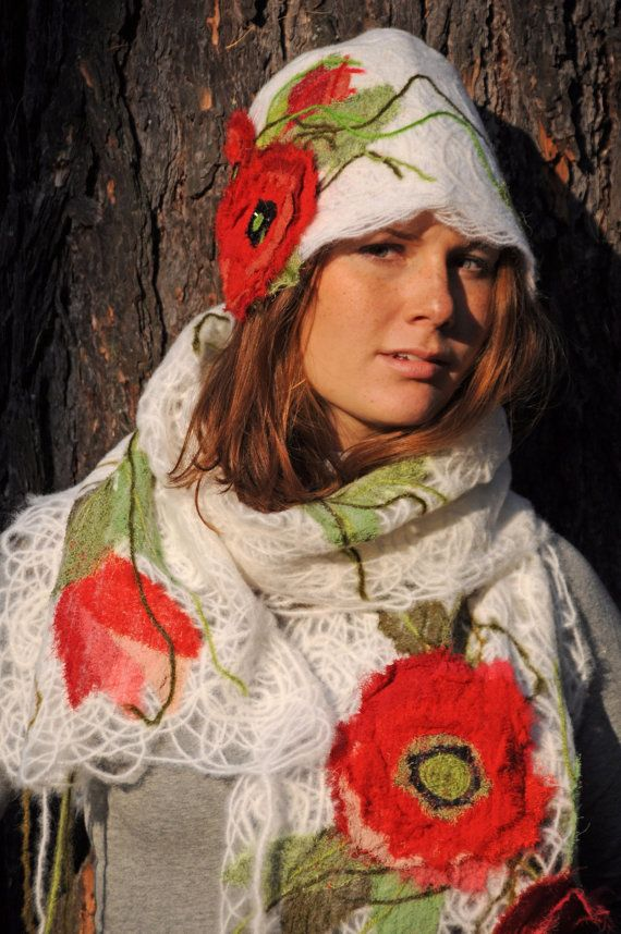 White wool scarf and a hat decorated with textile flowers poppies.