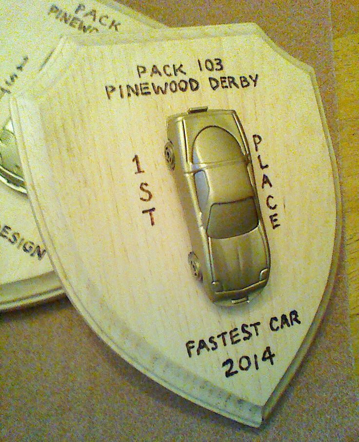 Wood burned shield plaque pinewood derby awards.
