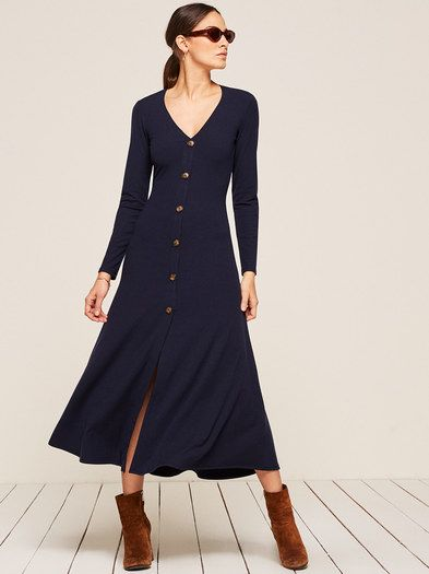 You're cute, click me.  This is a long sleeve, midi length dress with non-functional center front buttons.