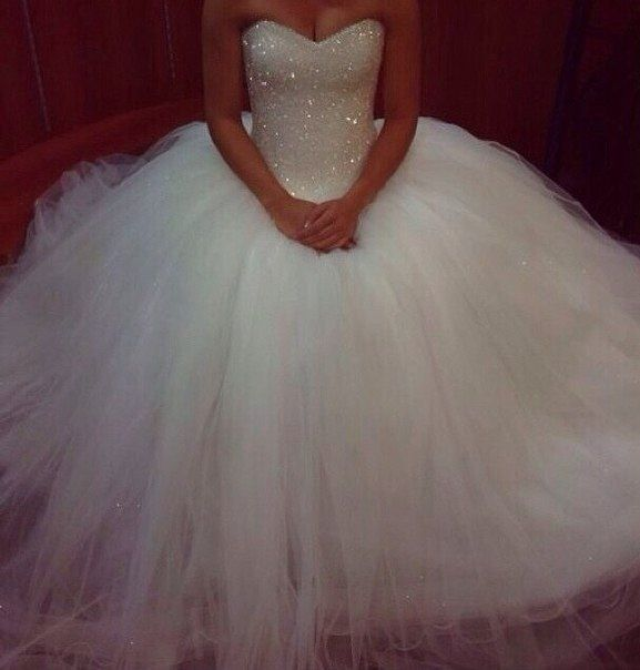 Cinderella wedding dress. Miley loves this, she wants to marry Angel.  So sweet.
