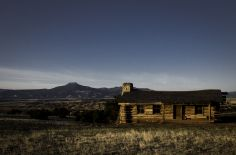 City Slickers Cabin on Ghost Ranch at sunrise, Pedernal mountain in the distance. Ghost Ranch, New Mexico.