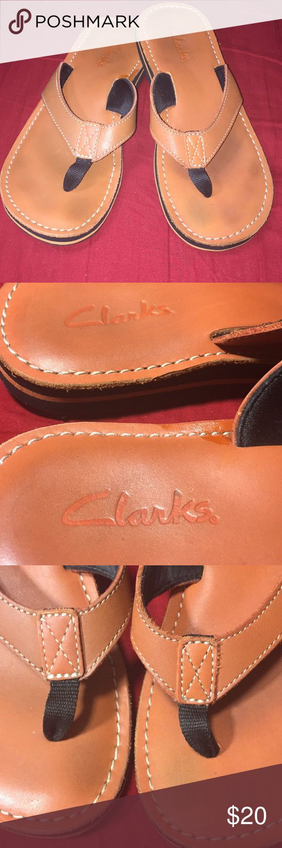 Tan leather Clarks sandals. Size 6 leather thong sandals. Top is leather, sole is man made material. Tan/orange over the top & black soles. Worn but have lots of life left in them. Clarks Shoes Sandals