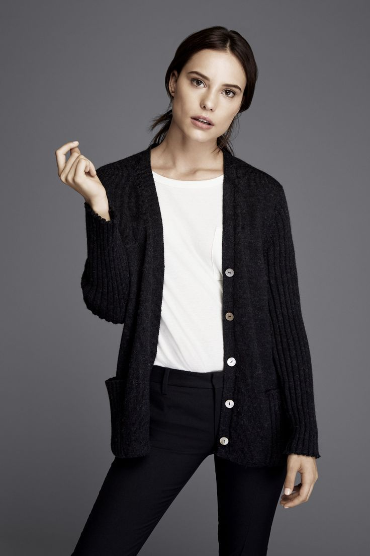 Black Cardigan with white buttons and pockets at the front. Best Sweaters Are Chic, Affordable, and Eco-Friendly. Ethical sustainable fashion | sustainable fashion ideas | sustainable fashion inspiration | sustainable style capsule wardrobe | sustainable style simple