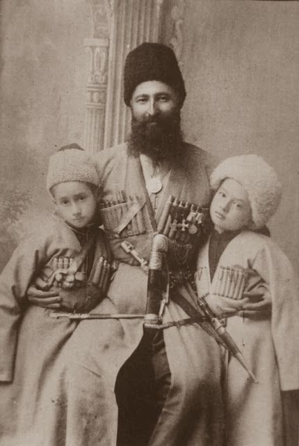 Georgievsky Chevalier Tatarkan Kaitov (Ossetian) with young sons. Both boys are armed with kama daggers. Photo beginning of XX century / Георгиевский кавалер Татаркан Кайтов (осетин) с малолетними сыновьями. Фото начала XX века.