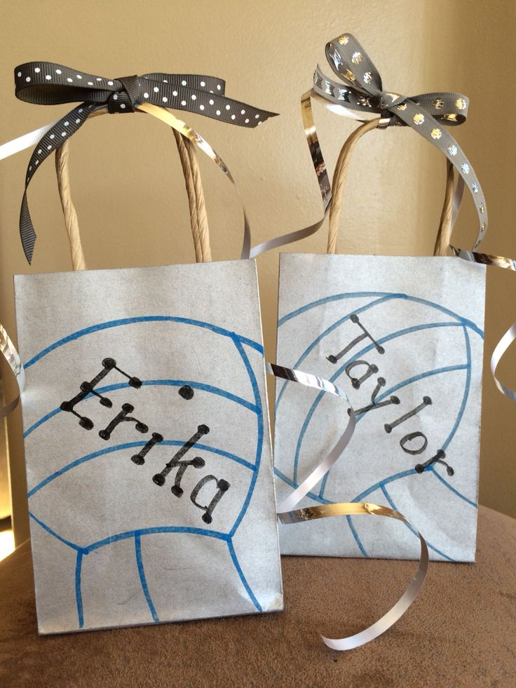 Gift bags for volleyball. Use small gift bags and then draw a volleyball on it.