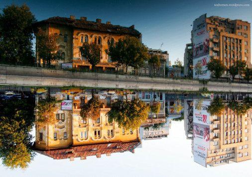 Reflections across Dambovita River Bucharest
