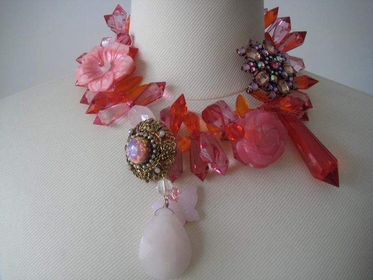 Pinks, oranges, reds and rose quartz.  Fierce  jewels