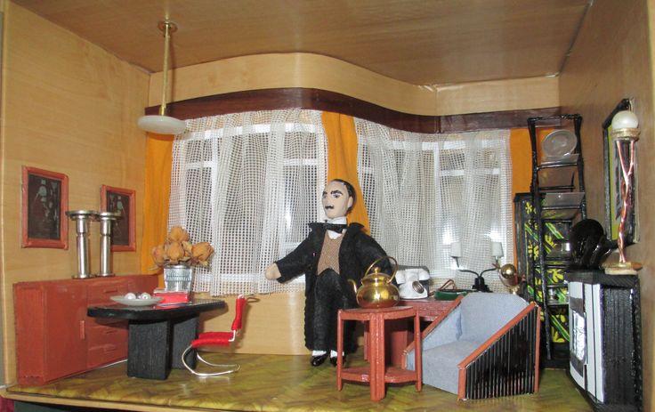Hercule Poirot in his work room