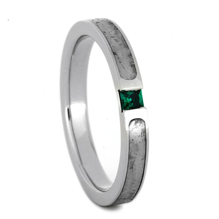 https://jewelrybyjohan.com/shop/palladium-engagement-ring-emerald-2809/ An eye-catching princess cut emerald shines at the center of this palladium engagement ring. The solid, natural Meteorite has been etched to reveal the c...