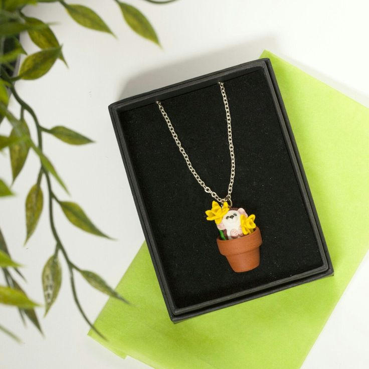 Pot Pets necklaces come in gift boxes with specially cut foam to keep them snug. What better way to start the week then putting on a necklace full of sunny daffodils. Go look at how adorable the hedgehog & cat are, just waiting for you to take them home.