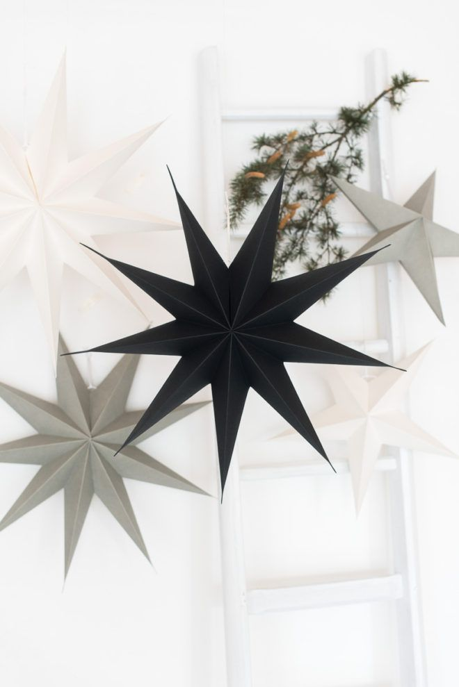 Christmas decoration with white, grey and black paper stars