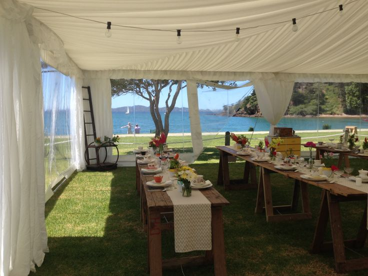 The view from inside the marquee on the lawn at Mahinepua Waterfront Beach House - with Susi Liddington Creative. Photography by Greta Kenyon