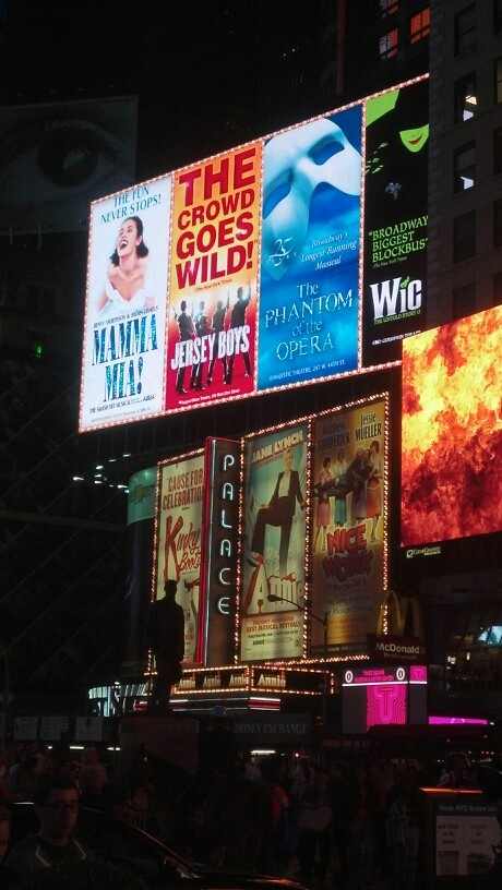 Various theater signs in Times Square.