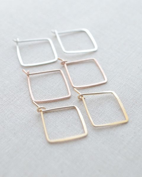 These hammered Square Hoops are perfectly petite. They are very lightweight and comfortable. Available in gold, silver and rose gold. By Olive Yew.