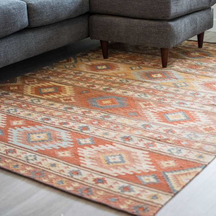 Take an Aztec-inspired print and update it in shades of cinnamon, sand, sky, and fieldstone -- that's our eye-catching new wool kilim area rug. Dimensions: 3' x 5', 5' x 8', 8' x 10' Materials: 82% Wo