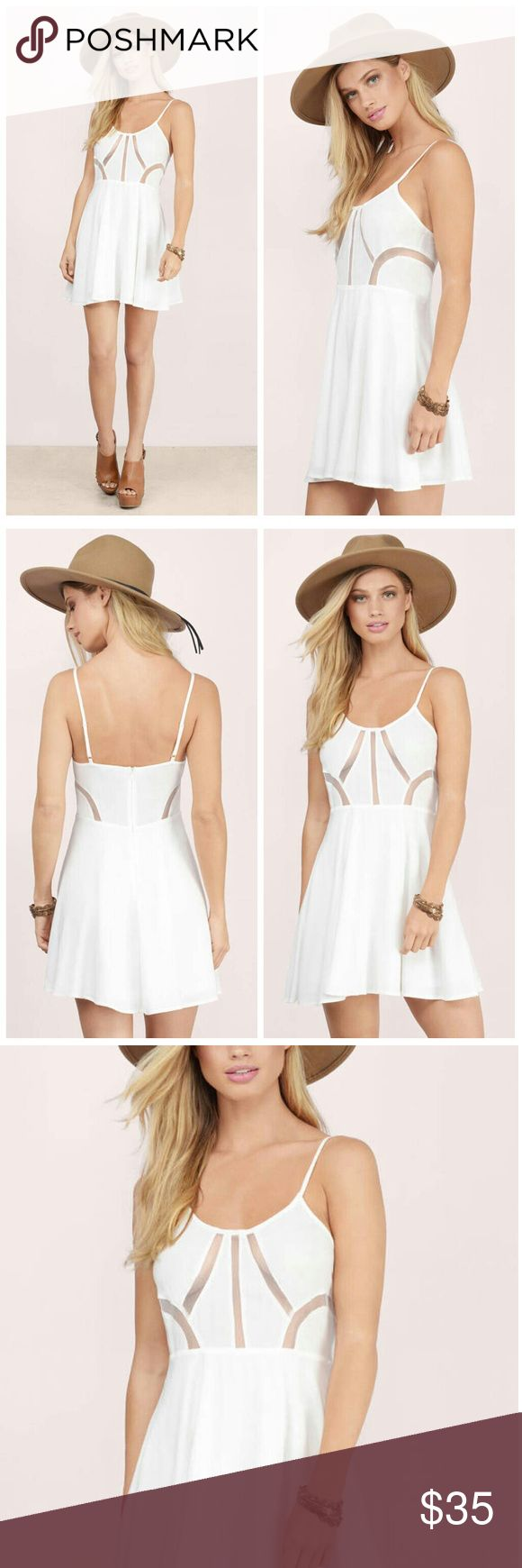 "Ivory Mesh cut out skater dress Ivory mesh skater dress with cut out designs.   Rayon (Self)Polyester (Lining & Contrast)ImportedDry Flatl  Waist: 25""/63.5cm Length: 31""/78.7cm Adjustable straps Back zipper closure Boutique Dresses Mini"