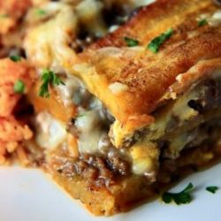 """Pastelon (SweeIngredients  1 lbs ground beef 1 onion,minced 3 gloves garlic, minced 1 green pepper, minced 1/2 chopped cilantro 2 tsp adobo 2 tsp oregano 2 Tbs vinegar 1 envelope sazón 2 bay leaves 8 green stuffed olives, halved 1/2 cup raisins 1/4 cup tomato sauce 4 plantains, peeled and sliced into strips 3 eggs 2 Tbs milk 2 cups white shredded cheese vegetable oil saltt Plantain """"Lasagna"""")"""