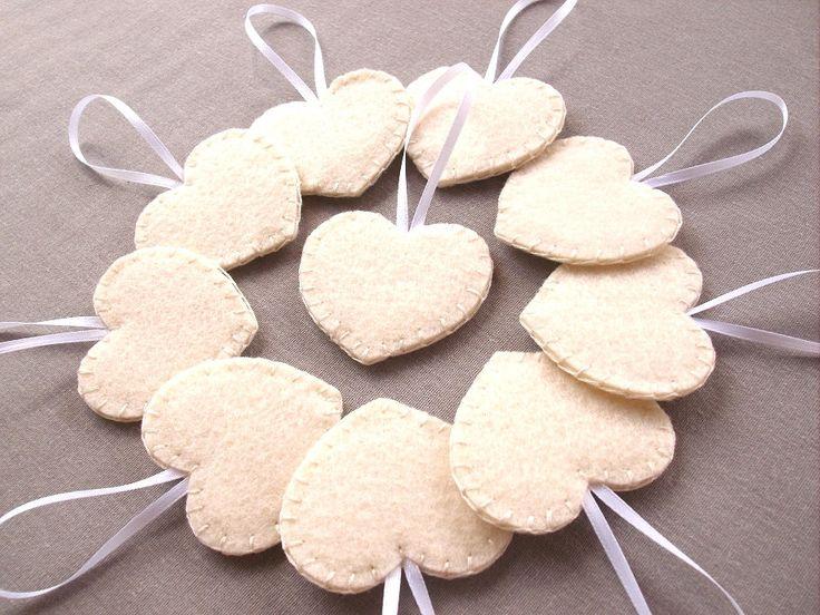 Set of 10 cream heart decorations, ivory wedding decor, wedding favors, felt heart ornaments, off white felt hearts, bridal decor by PeachPod on Etsy https://www.etsy.com/listing/181995524/set-of-10-cream-heart-decorations-ivory