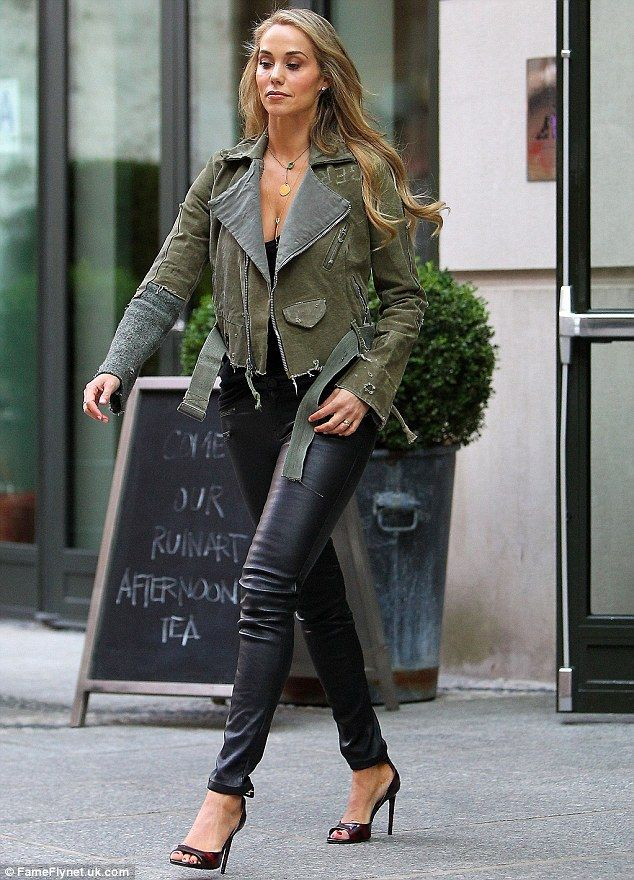 Shabby chic: Elizabeth Berkley rocked a pair of tight black leather trousers and a distressed jacket from designer husband Greg Lauren's spring collection for New York Fashion Week on Wednesday