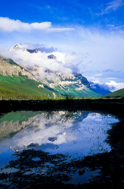 Clouds at the summit of Mount Wilson and the North Saskatchewan River. Banff National Park, Alberta, Canada.  Photo: Jerry Mercier via Flickr