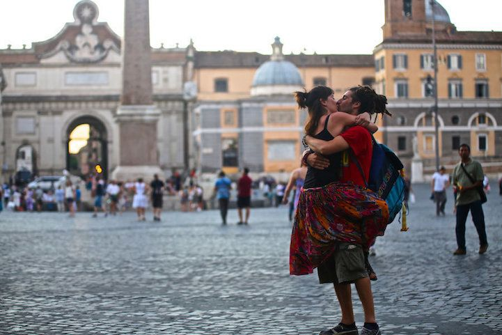 Traveling Photographer Captures Couples Kissing in Public Around the World