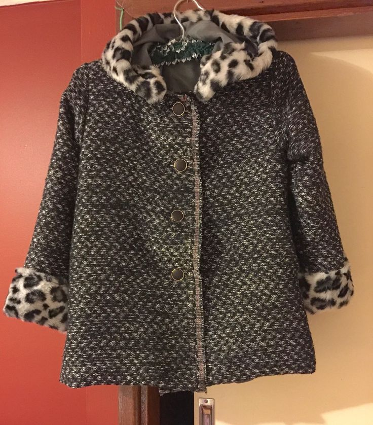 Lined Woollen Childs Coat with faux fur trim.