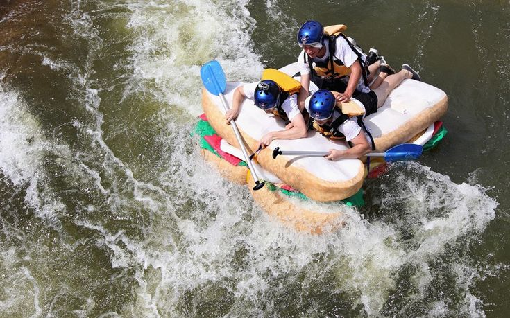 Competitors tackle rapids on a raft shaped like a sandwich during the Red Bull Rapids at Penrith Whitewater Stadium in Sydney