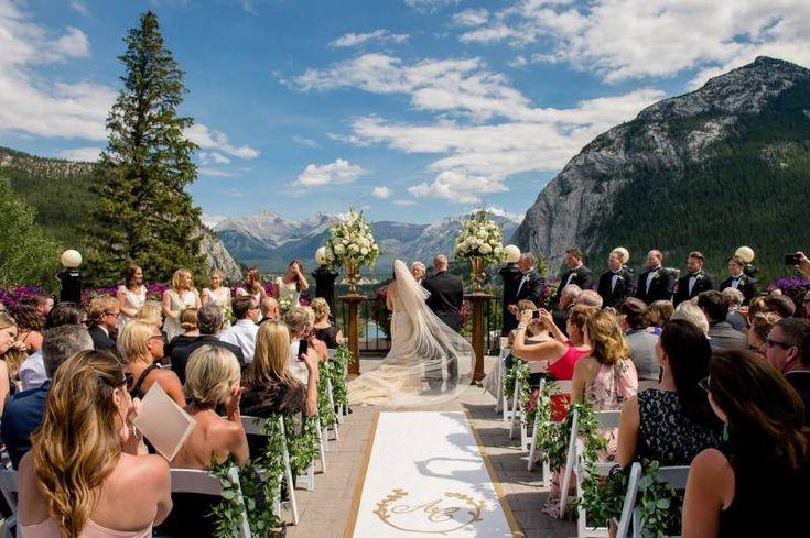 Ceremony on the balcony. Luxurious Garden Wedding at the Fairmont Banff Springs via Calgary Bride