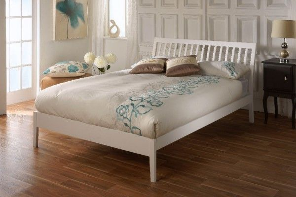 The Ananke bedstead is made from hardwood and finished in a white glaze.  The bed features a stylish curved slatted headboard and tasteful angled legs that add an elegant simplicity to the design. This gorgeous bedstead will work well in most bedroom settings.