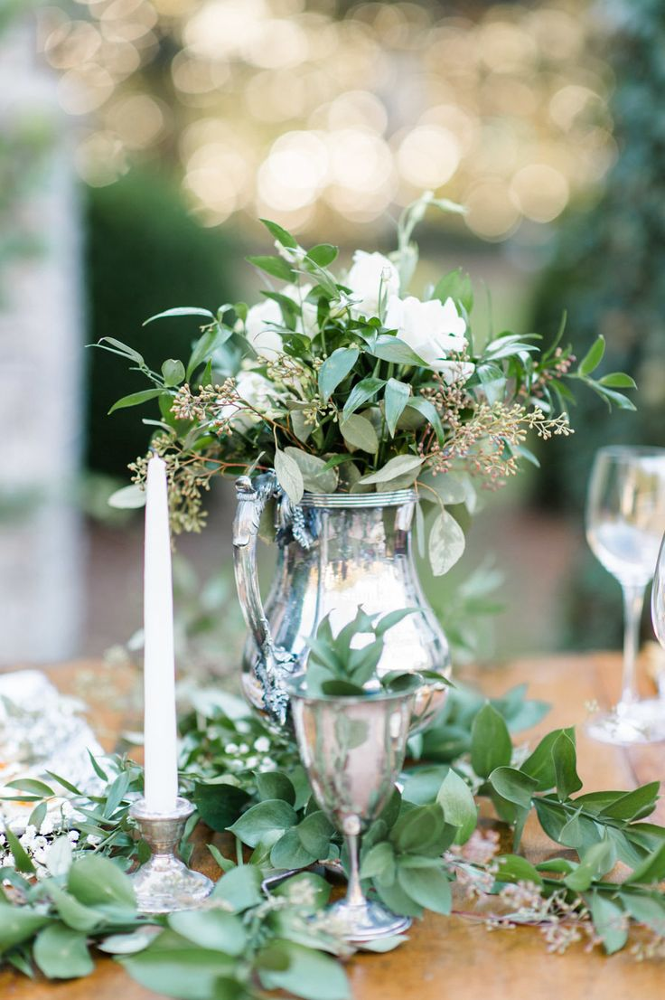 #Vintage Elegance| Mostly Green in #Centerpiece | On Style Me Pretty - http://www.StyleMePretty.com/2014/01/02/rustic-winter-wedding-inspiration/ Caroline Lima Photography
