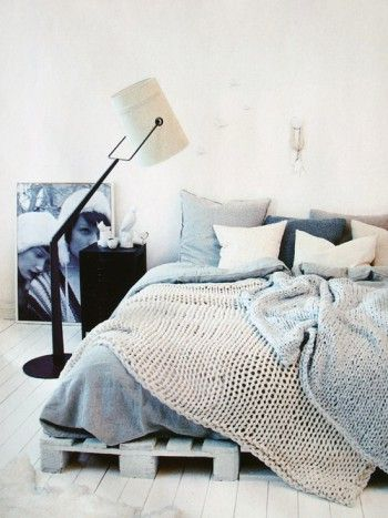 'how to dress a bed' lots of layers, grey, white, natural, knits, textures. love the industrial style floor lamp.