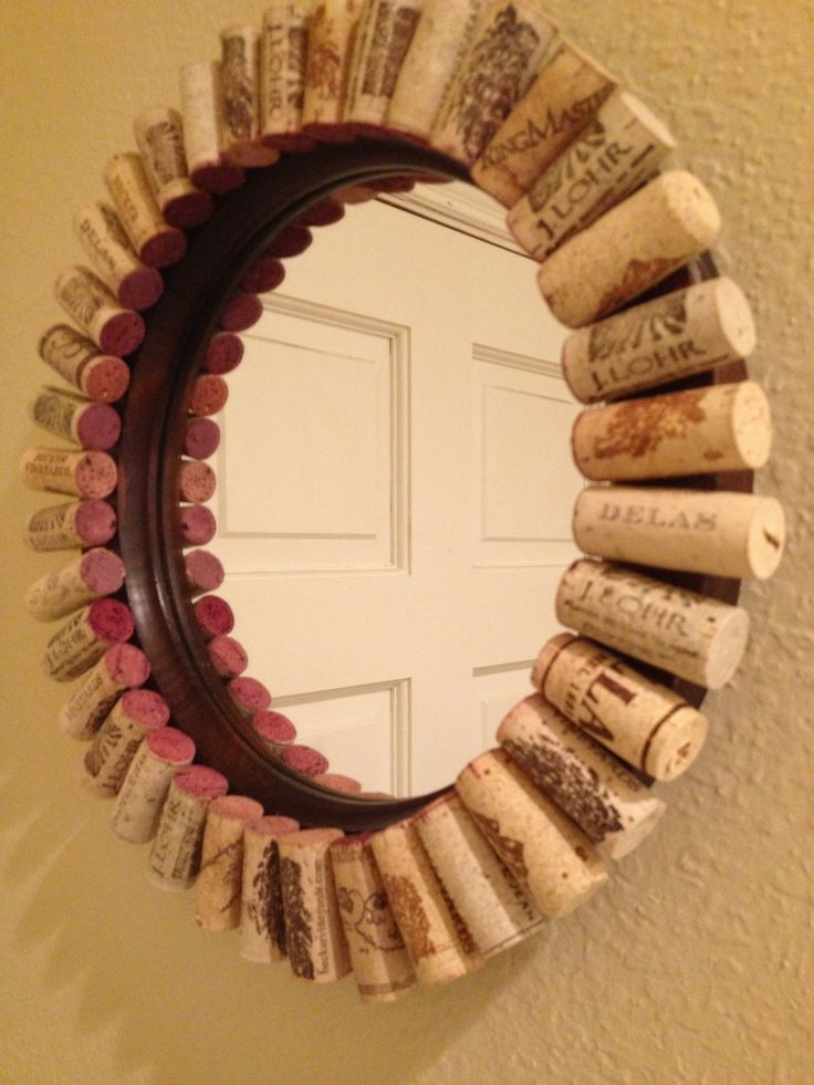 Recycled wine corks made into a frame for a repurposed round mirror.