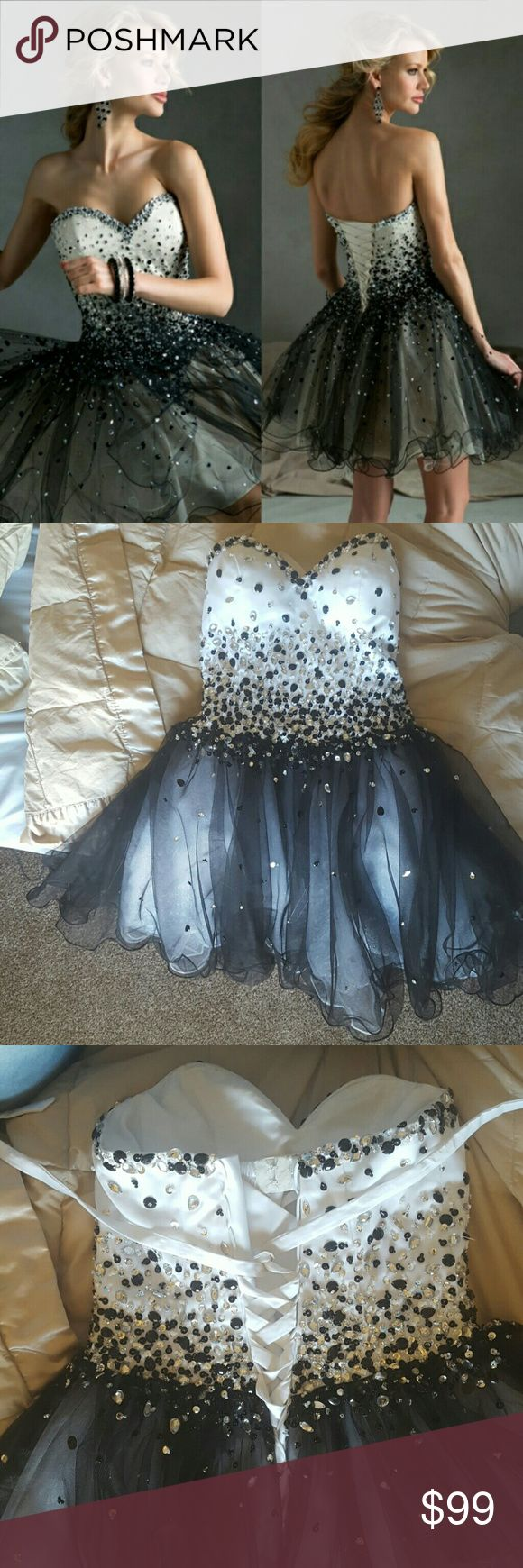 Sparkly Short Sexy Homecoming Dress corset back, only used once, in brand new condition, makes your boobs look good and fits most people because of the corset back, you can tighten it to fit and adult small or medium. Dresses Strapless