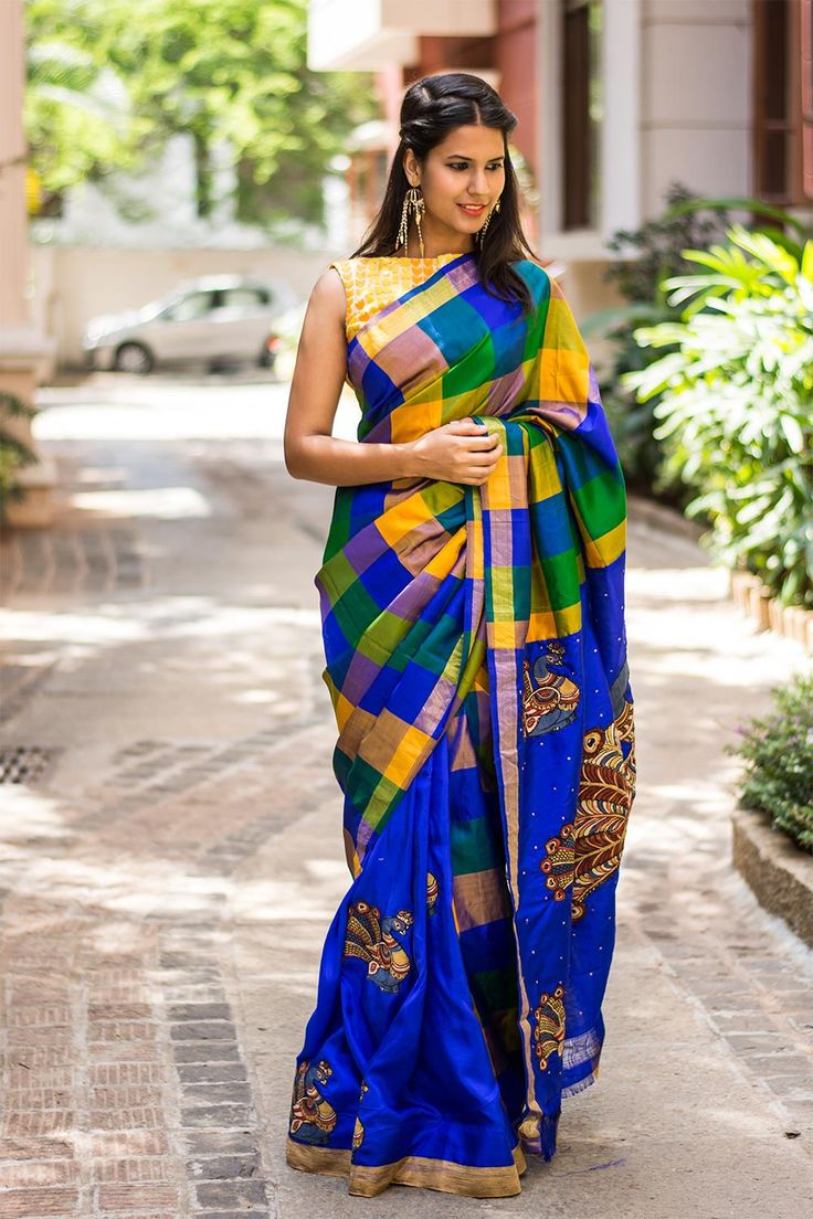 Habutai silk pleats in a striking blue with a checked half in pure Gadwal silk, having a Kalamkari appliqués on pleats & pallu…yet another genius combination! If you want a silken drape with a difference.Pair with a yellow blouse, a mustard blouse for a nice contrast.
