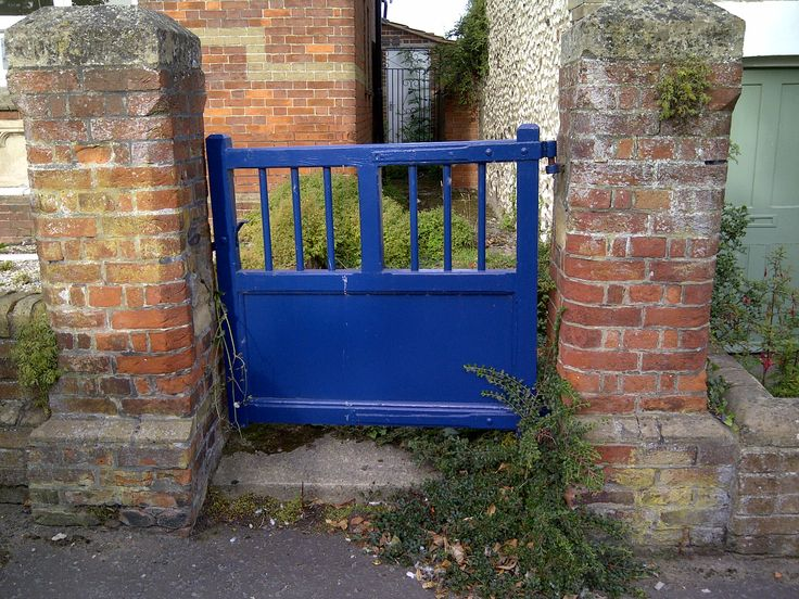 I like this electric blue gate contrasted with the bricks