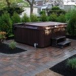 Let us help you with a paver patio for your hot tub!