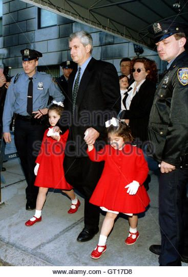 Edwin Schlossberg, husband of Jacqueline Kennedy Onassis's daughter Caroline, leads his daughters Rose (L) and Tatiana (R) from their grandmother's apartment building, as a nanny (Rear) carries their 16-month-old brother John, May 21 Stock Photo